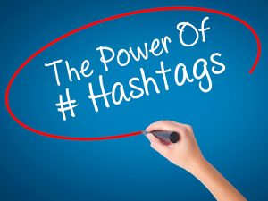 "Red circle with the phrase ""The Power of # Hashtags"" in the center"