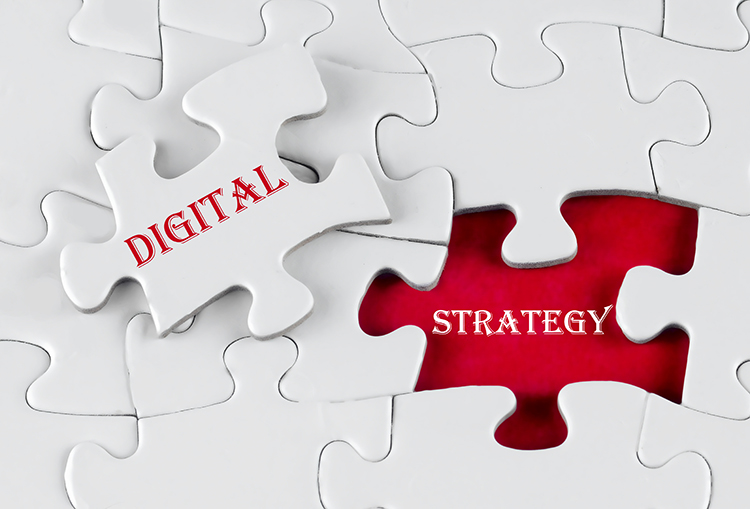 White puzzle pieces with one set aside that has red and white words saying digital strategy